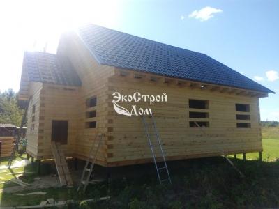Дом из бруса с теплым крыльцом под усадку
